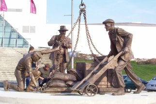 DOCKERS: Bronze public memorial sculpture 9ft figures - ExCel Exhibition Centre Docklands London