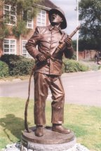 WATER ON: 7ft bronze commemorative sculpture - 1960s fireman